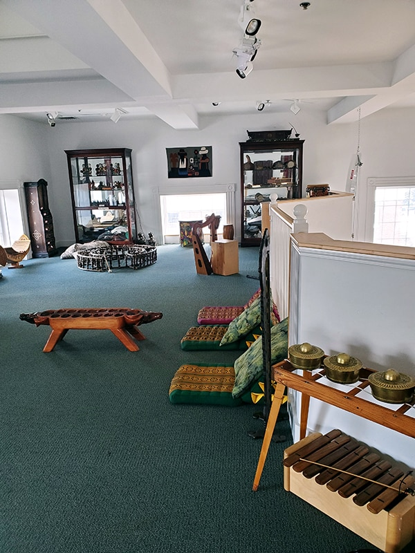 room set up with seats, musical instruments, and interactive pieces