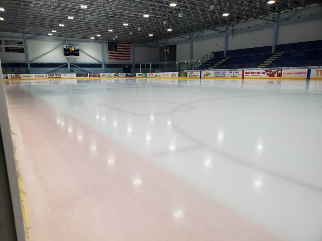 A smooth ice rink in an indoor arenna
