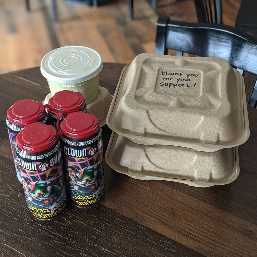 to go containers and beer on a table with the words 'thank you for your support' on top