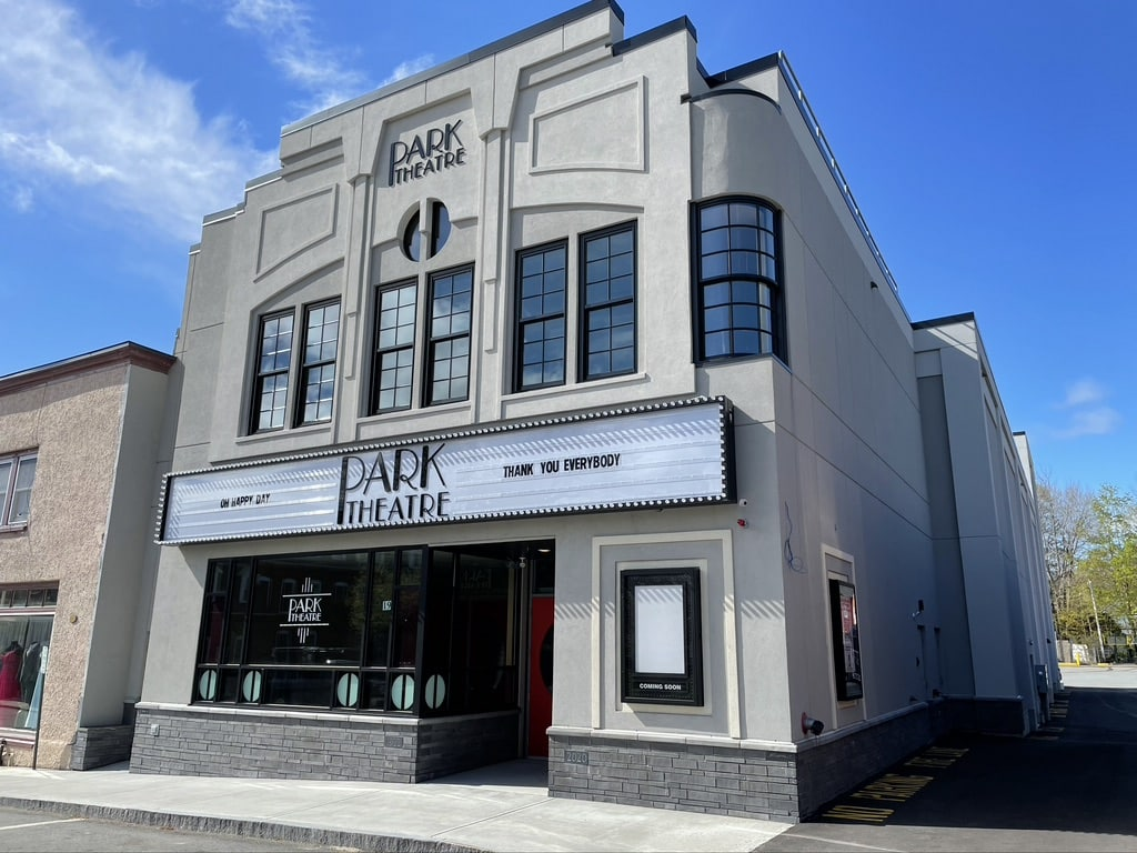 The front of a recently built movie theatre with a white marquee and name of Park Theatre in retro lettering
