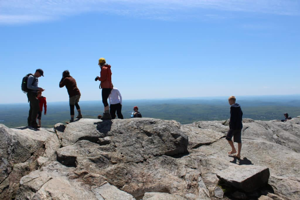 Hikers on the summit overlooking the valley