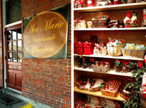 shelves filled with Christmas themed chocolates and gift boxes.