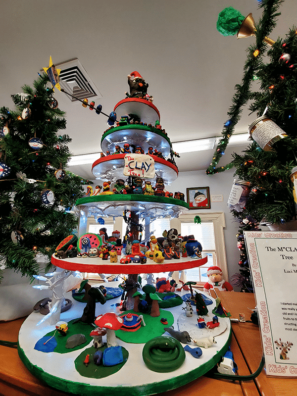 A tiered tree filled with clay figures on each level