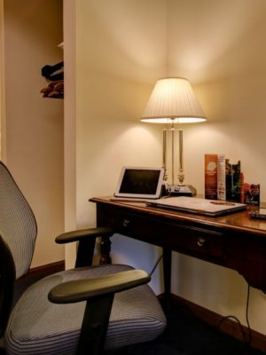 Desk with lamp and guest computer with adjustable task chair