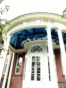 domed entrance into a brick library with blue mural on the ceiling