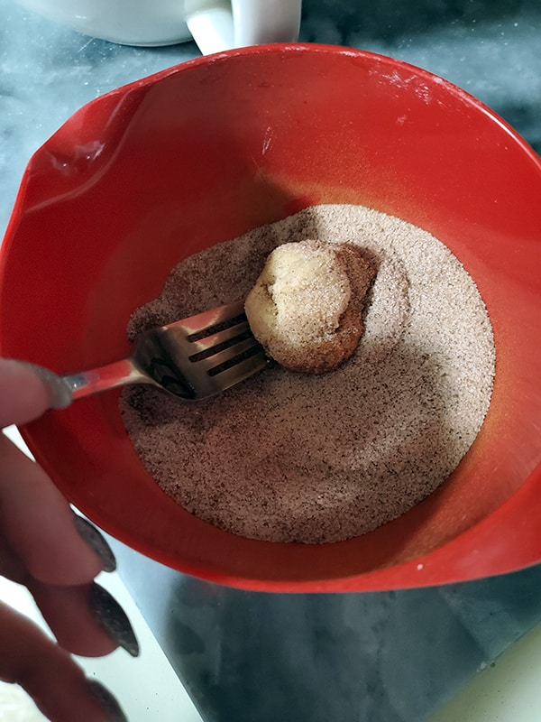 bowl of sugar for coating the cookie dough